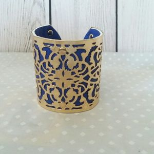 Jewelry - Gold laser cut cuff bracelet with purple lining
